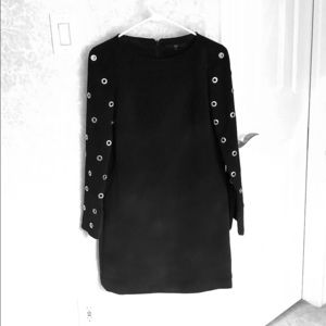 Tibi long sleeved black dress with grommet detail